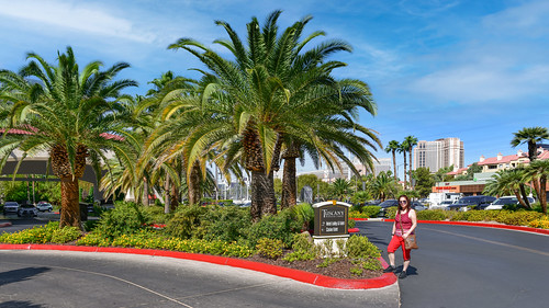 luxurious mainentrance usa nevada lasvegas woman attraction destination tuscanysuites hotel casino people road view sky mediterranean famous vacation palm architecture street tourism travel