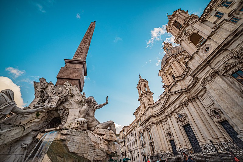Wide angle shot of the fountain and the church in piazza Navona, Roma, Italia