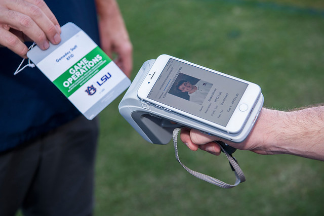 A person scanning a field-access pass.