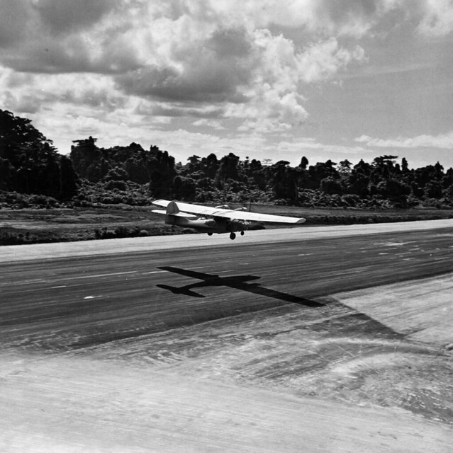 A good night's work behind it, a PBY Catalina Black Cat lands on a strip at Bougainville - the early morning sun making it seem almost white as the rays reflect off the plane's wing surfaces