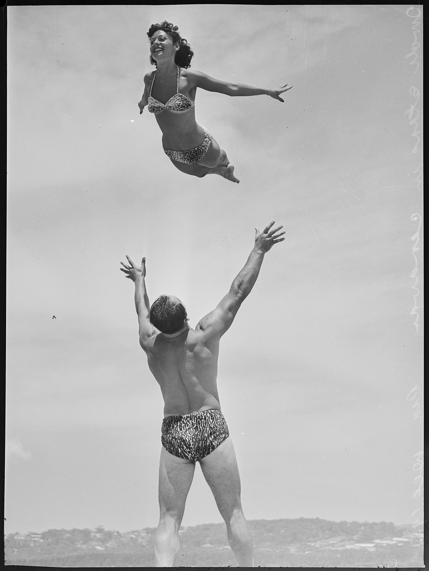 Acrobatics at the beach by two Tivoli stars, December 1951