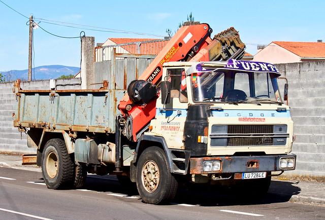 A huge self-loading crane for a 4x2 tip truck