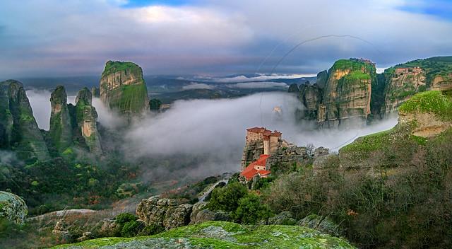 St.Barbara (Rousanou) Meteora monastery in mist panorama