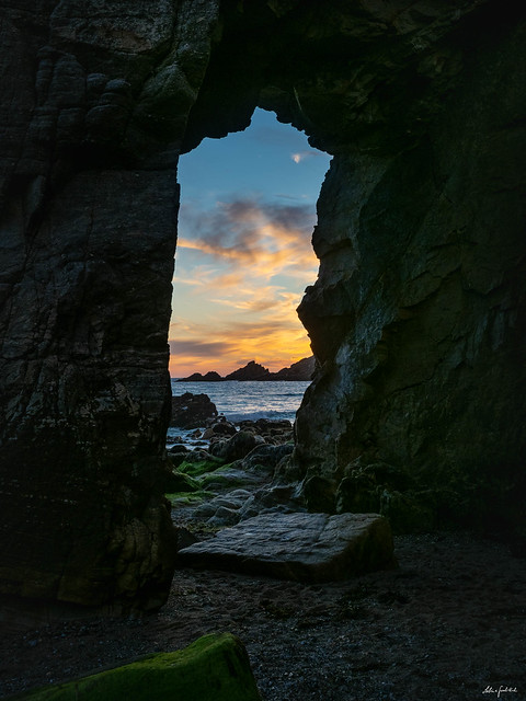 sunset view through a rock window