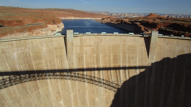 Arizona - Lake Powell:  From the Glen Canyon Dam Bridge - see shadow on the dam wall -  the view of the reservoir & red rock's is stunning.