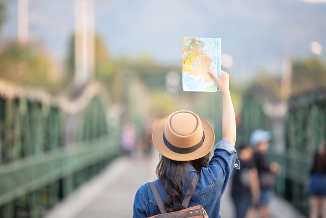 female-tourists-hand-have-happy-travel-map