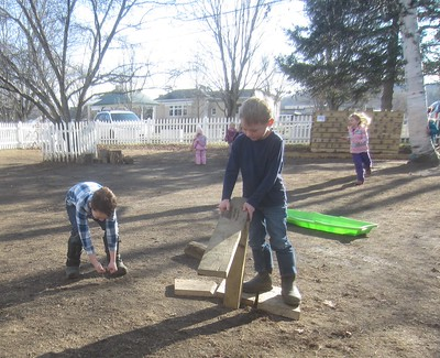 chopping the wood with the standing saw