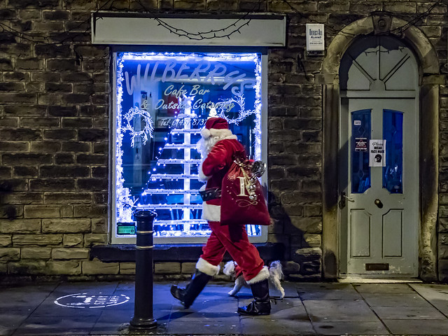Santa back out in Uppermill walking the dog
