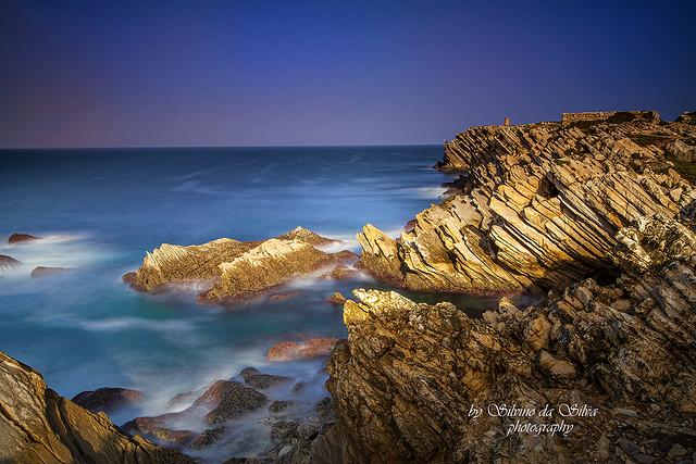Seascape and Landascape in Papoa Beach, Peniche. Portugal