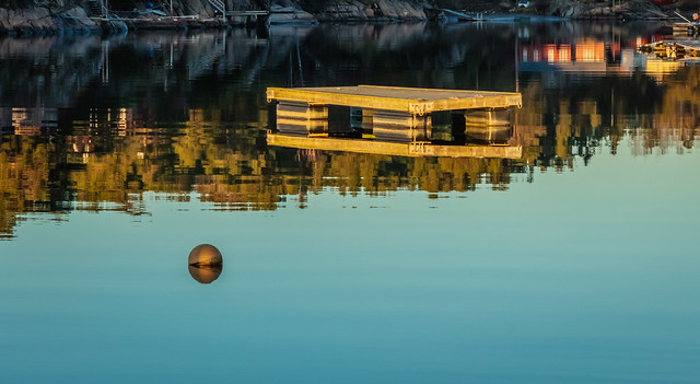 Reflections from a bathing jetty at dawn II