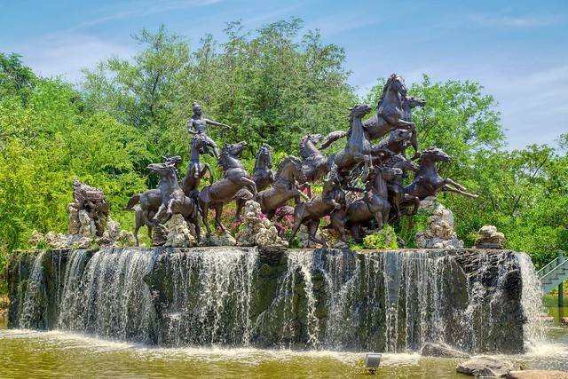 Horse sculpture with water feature in the Garden of Gods in Muang Boran (Ancient City) in Samut Phrakan near Bangkok, Thailand