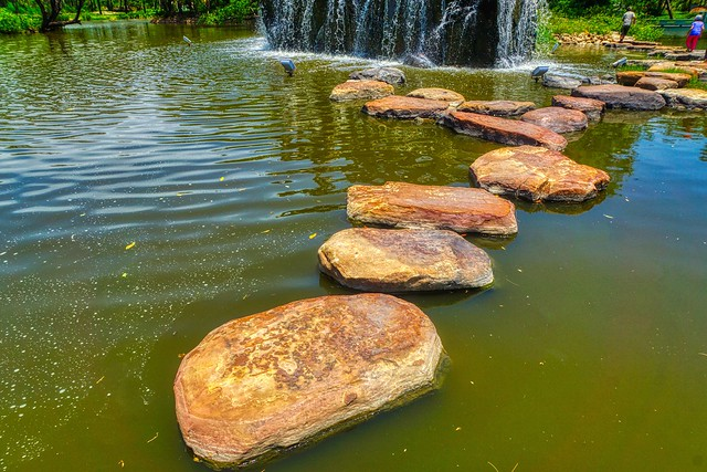 Stepping stones to cross a pond in Muang Boran (Ancient City) in Samut Phrakan near Bangkok, Thailand