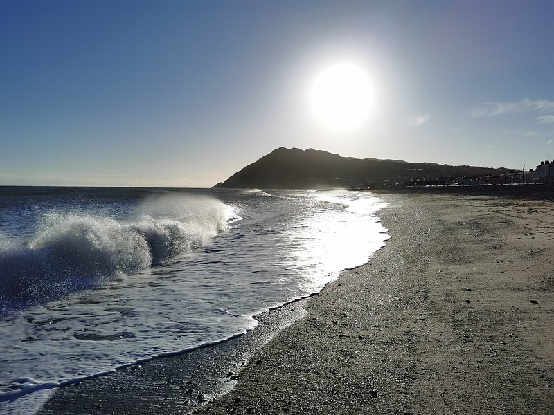 The sun, the Irish sea, the beach and Bray Head