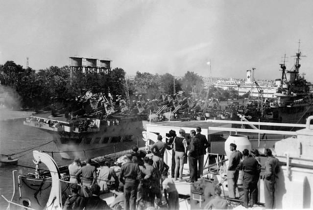 War is over: homeward bound, passing an aircraft carrier, 1945