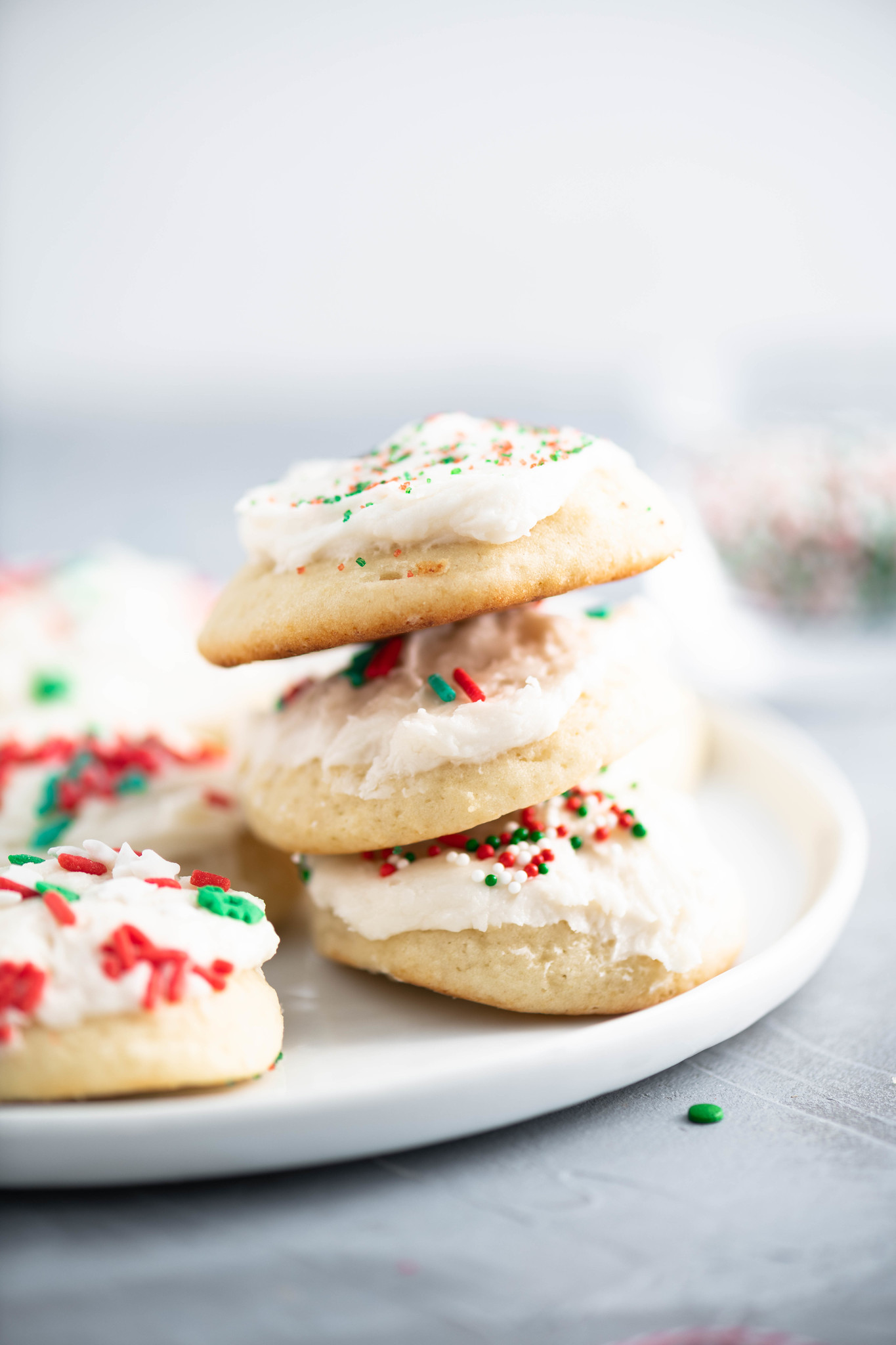 These Italian Christmas cookies are the most tender, fluffy cookie around. With a cake-like texture and a not too sweet buttercream frosting, these are the perfect Christmas cookie.