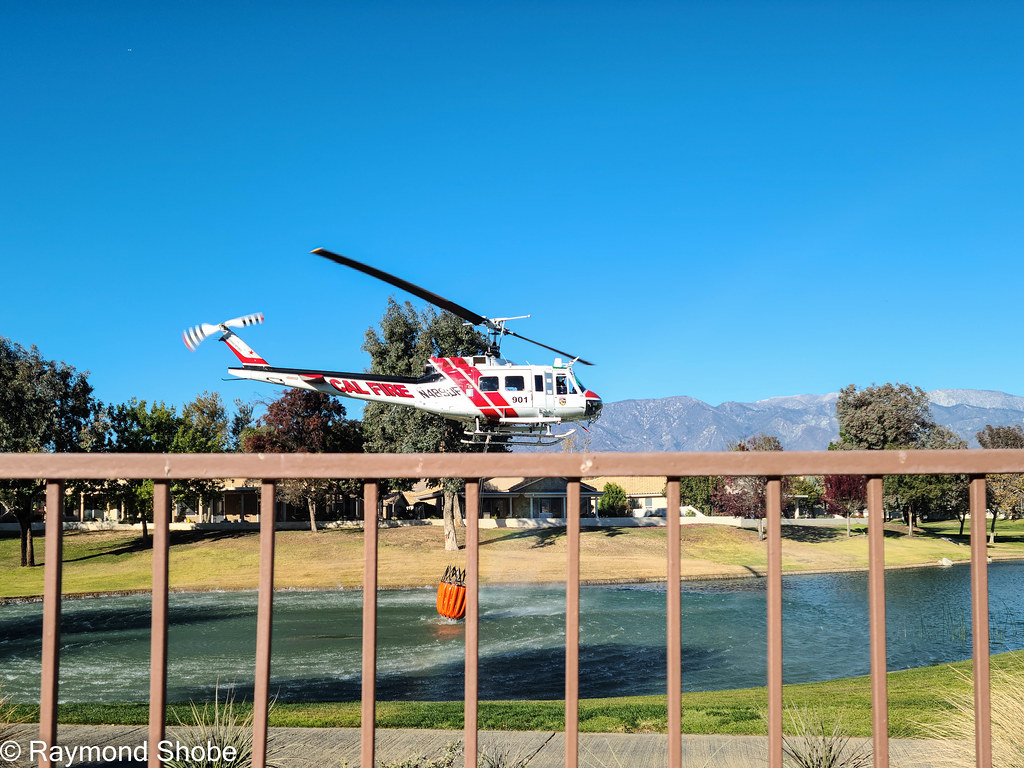 Wildland fire south of us has water dropping helicopters scooping up in our country club. Sun Lakes Country Club Banning