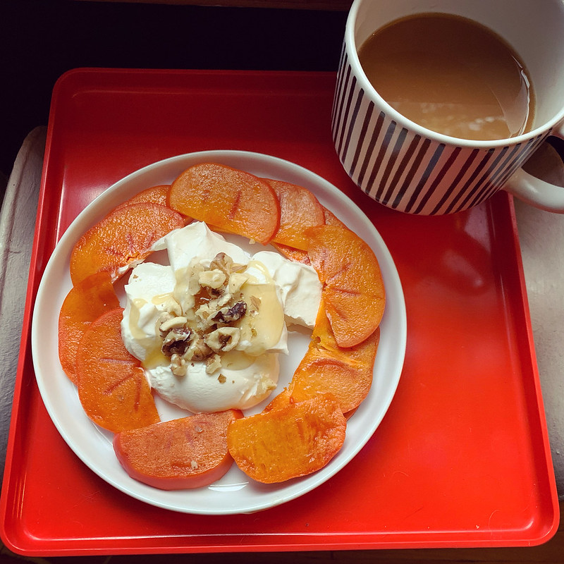 Simple but delicious breakfast. Labneh with honey and walnuts and sliced fuyu persimmons.