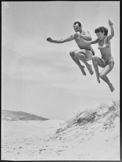 Acrobatics at the beach by two Tivoli stars, December 1951. | by State Library of New South Wales collection