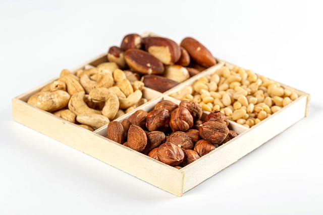 Wooden box with a selection of different types of delicious nuts