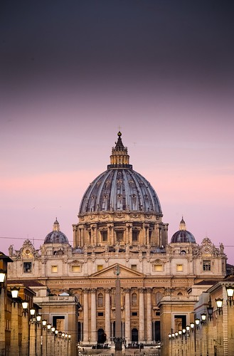 St Peter's Basilica Rome around daybreak when the streetlamps are still lit and the dawn sky casts a soft pink glow over St Peter's, with not a coach in sight. From Great Pilgrimage Sites of Europe. Photo copyright Derry Brabbs