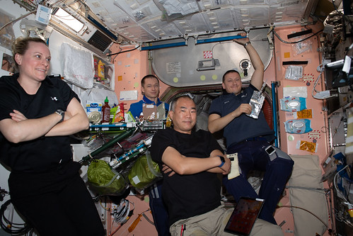 Expedition 64 crew members relax after a meal | by NASA Johnson