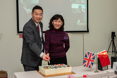 Zhang Rong, Party Secretary of the School of Languages, and Michael Ge, UCLan Director of China Operations, cut a cake marking the 20th Anniversary of collaboration between SUIBE and UCLan