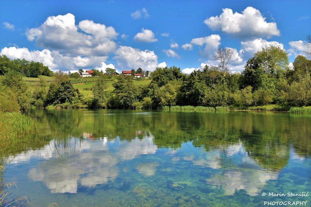Skukani, Croatia - Floating clouds in river Dobra...