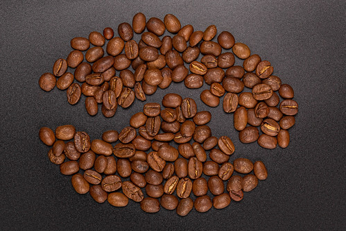 Roasted coffee beans on a black background | by wuestenigel