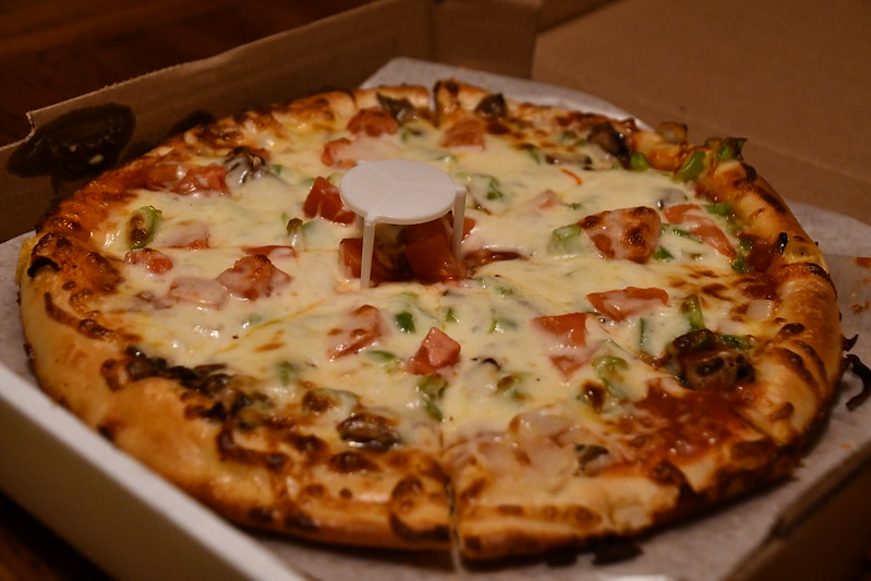 Grammas: Veggie specialty pizza: Onion, Mushroom, Green Pepper, Tomato. Medium for $12.75.