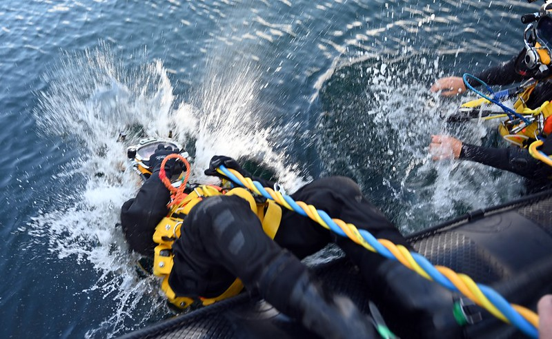 Sub-Lieut Tahlia Britton enters the water from off a Navy RIB