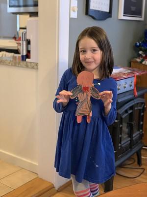 gingerbread girl in a matching blue dress