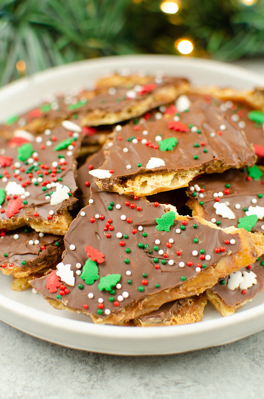 Peanut Butter Saltine Toffee - the classic saltine toffee with a peanut butter layer! So easy and delicious - Santa is going to love them!