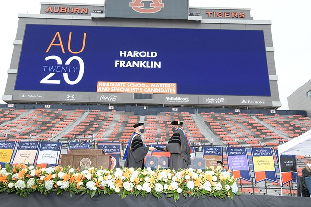 Harold Franklin walks across the graduation stage.
