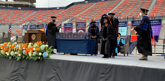 Harold Franklin giving Shari L. Williams her doctoral sash.