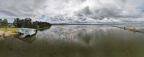 holidays clearskies people cloudy australia reflections 180degrees graffiti aerial boathouse newsouthwales clouds coastal rainclouds tuggerahlake nsw scenery ocvercast travel lake scenic afternoon outdoors longjetty coast centralcoast water wharf