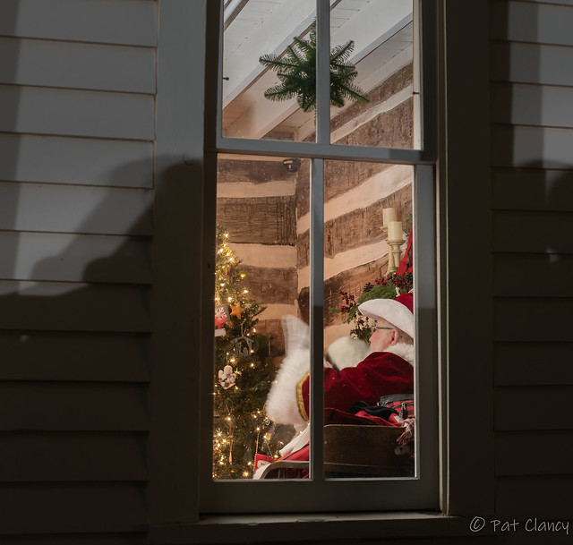 Looking through the window at Santa and the Mrs