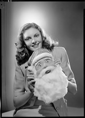 Portrait of J. Stanley Johnson as Miss Nightingale with Father Christmas mask, 1947, Max Dupain