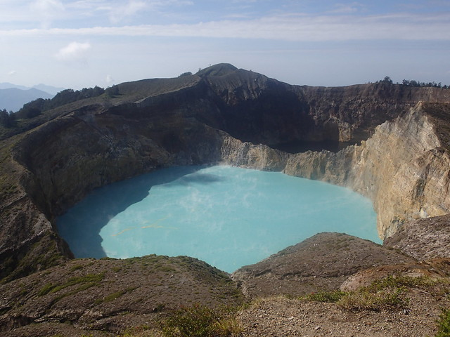Volcano Kelimutu (1639m) is famous for its three crater lakes that change colors through the year. The central lake is bright blue.
