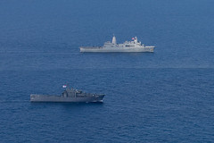 RSS Endurance (207) and USS Somerset (LPD 25) sail together in the South China Sea, Dec. 11. (U.S. Marine Corps/Lance Cpl. Brendan Mullin)