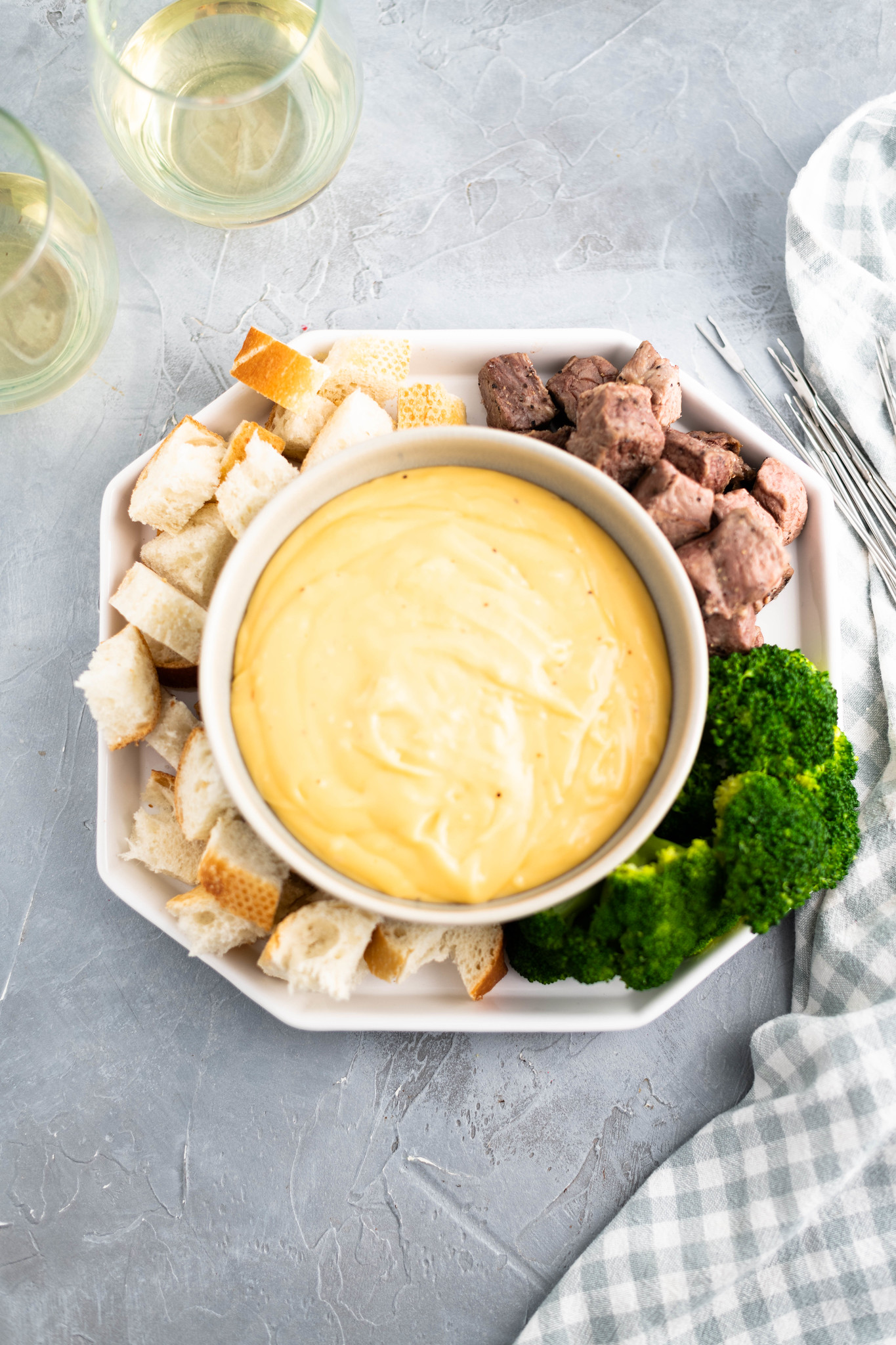 Whether for a party, a date night in or a celebration, this Three Cheese Fondue will be a big hit. Packed with sharp cheddar, smoked gouda and sharp parmesan cheeses and served with delicious dippers.