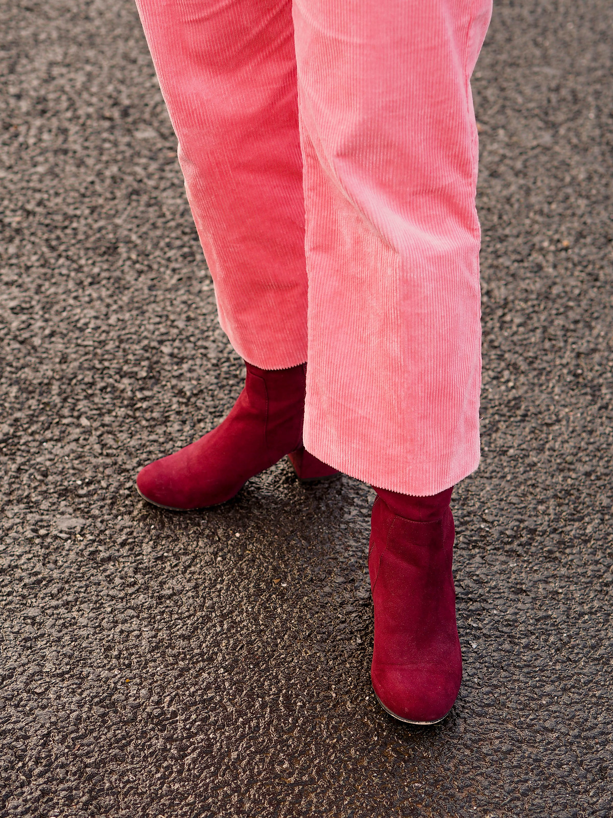 An Orange, Pink and Red Colour Combination Just WORKS (Catherine Summers AKA Not Dressed As Lamb wearing orange giraffe print coat, pink corduroy jumpsuit, red and white patterned sweater and burgundy boots)
