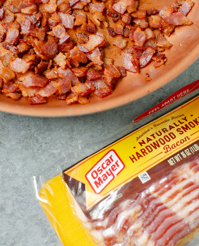 cooked bacon in a copper pan; package of Oscar Mayer bacon