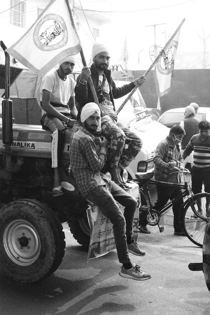 Protesters riding a tractor at Tikri farmers' protest site, Delhi. Image by Manu Moudgil