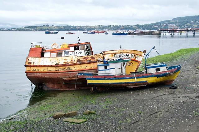 Low tide and old boats in Quellon, Isola de Chiloé, Chile.