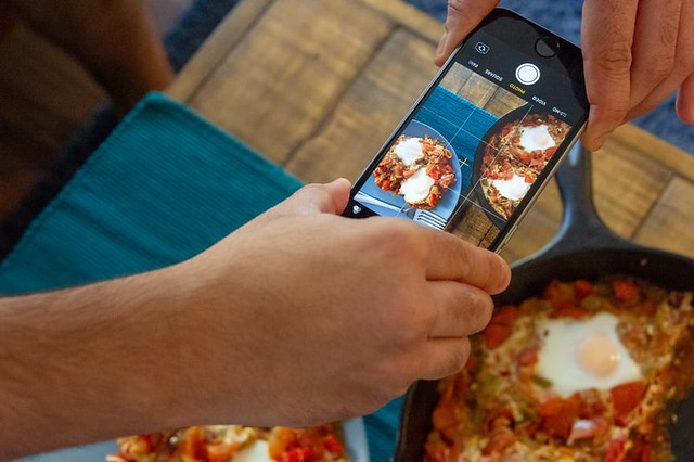 Taking an phone camera photo of food at a cookery class