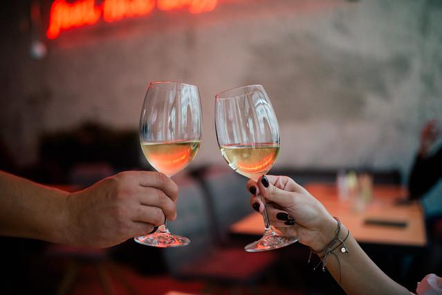 Couple having toasting wine at restaurant closeup.