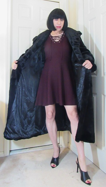 However to keep me warm while wearing a mini dress how about putting this long length fur coat on!