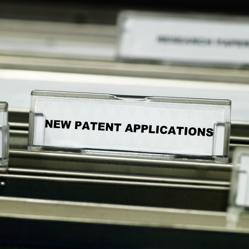 A close up photo of some files with the name New Patent Applications visible
