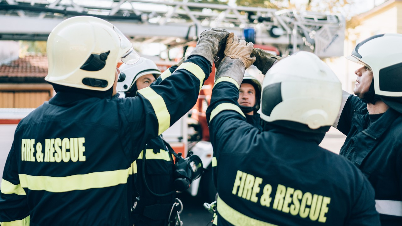 Fire & Rescue service team high fiving
