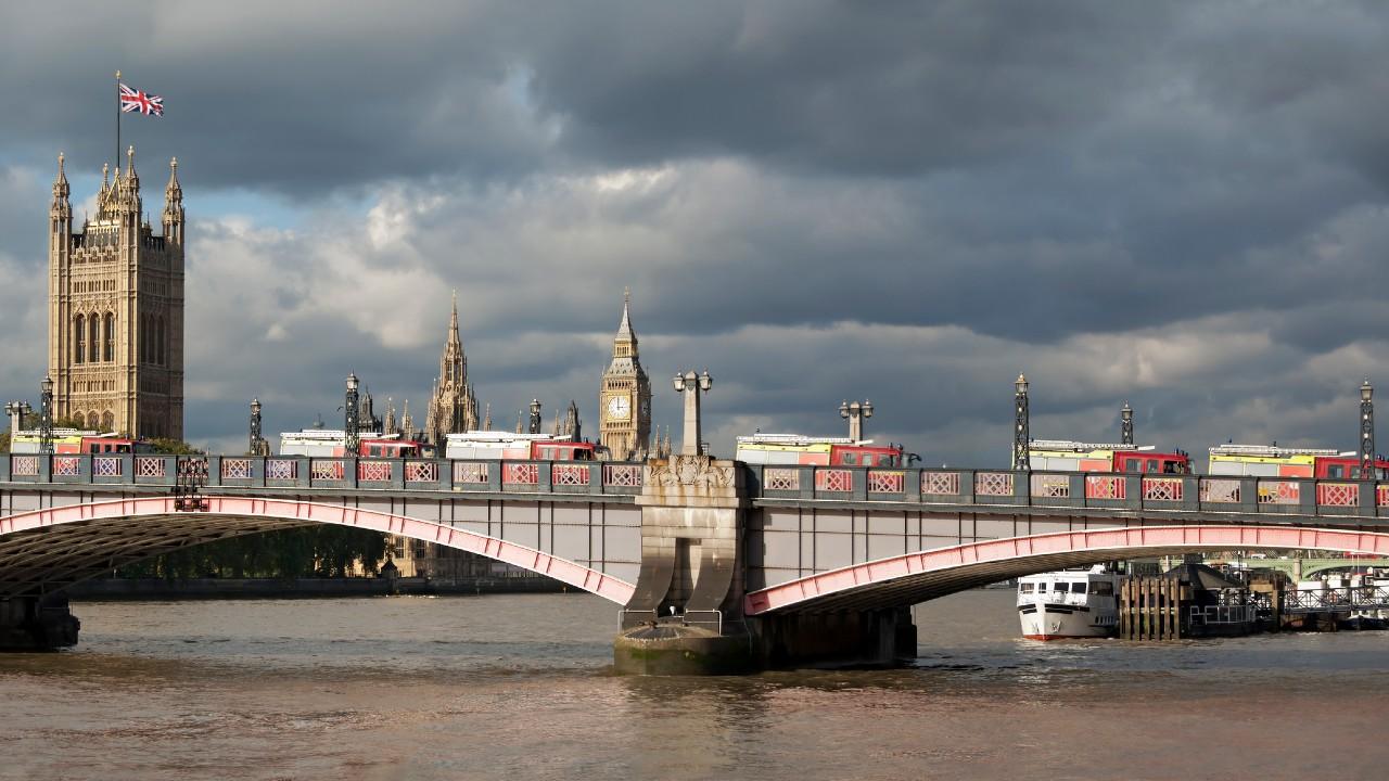 Fire engines travelling across Lambeth Bridge in London